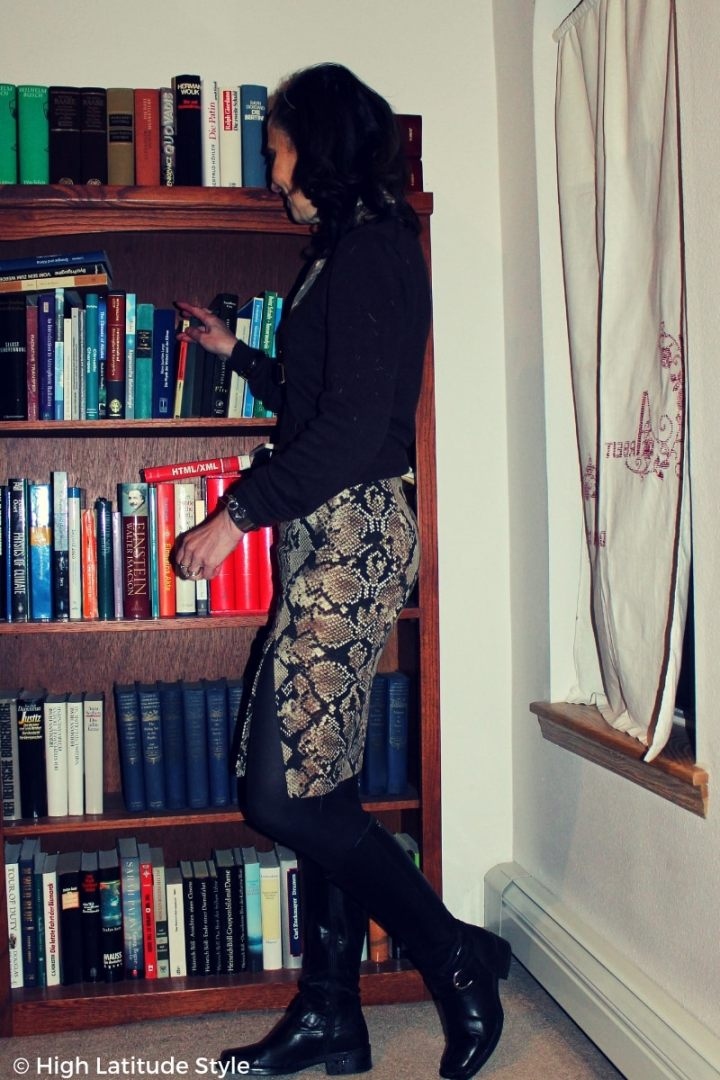 #agelessstyle snake print skirt with side slit, sweater and tall black boots