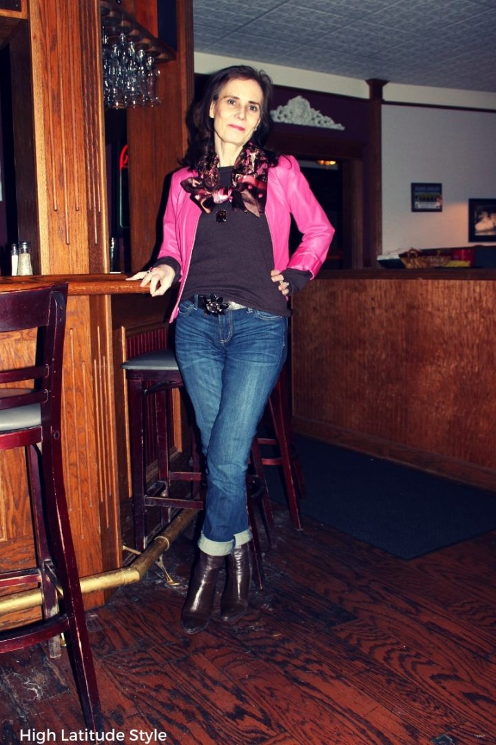 Nicole of High Latitude Style wearing a pink jackte with brown boots, accessories and sweater reviewing boyfriends by Kut From The Kloth