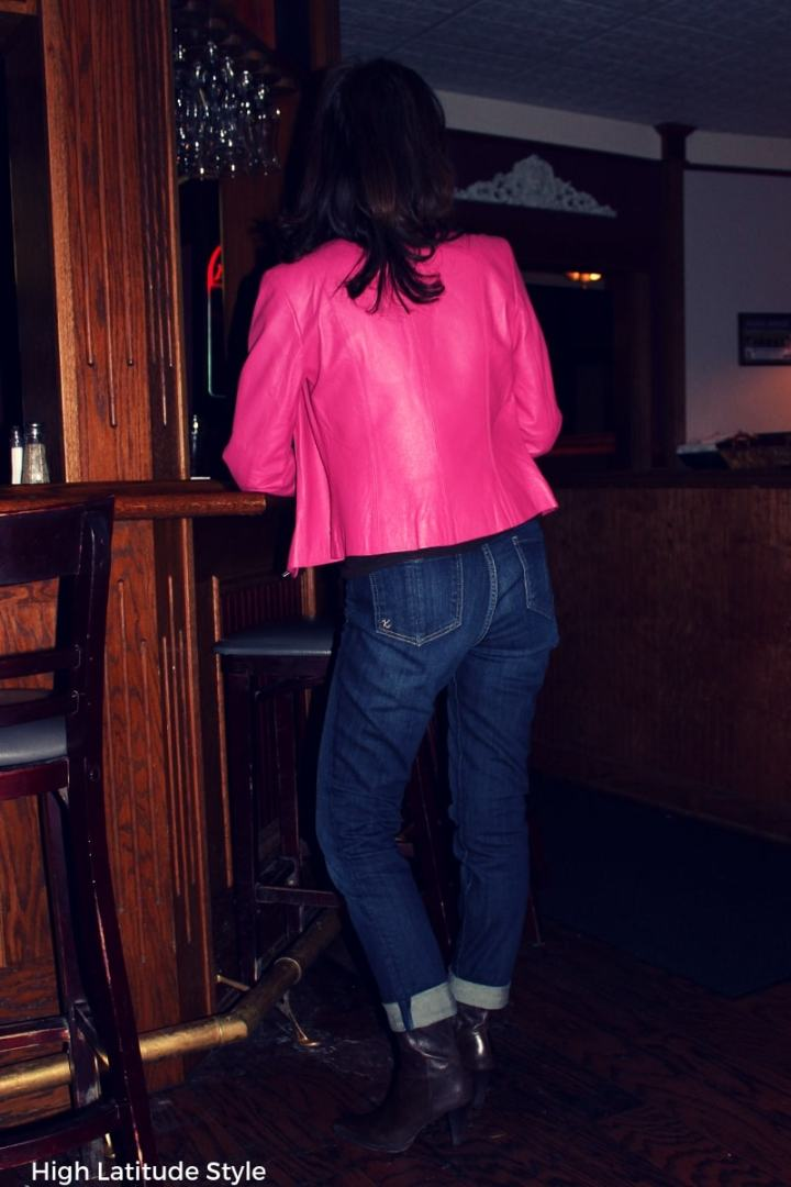 #casuallooks woman wearing denim pants and a pink tailored jacket with brown footwear