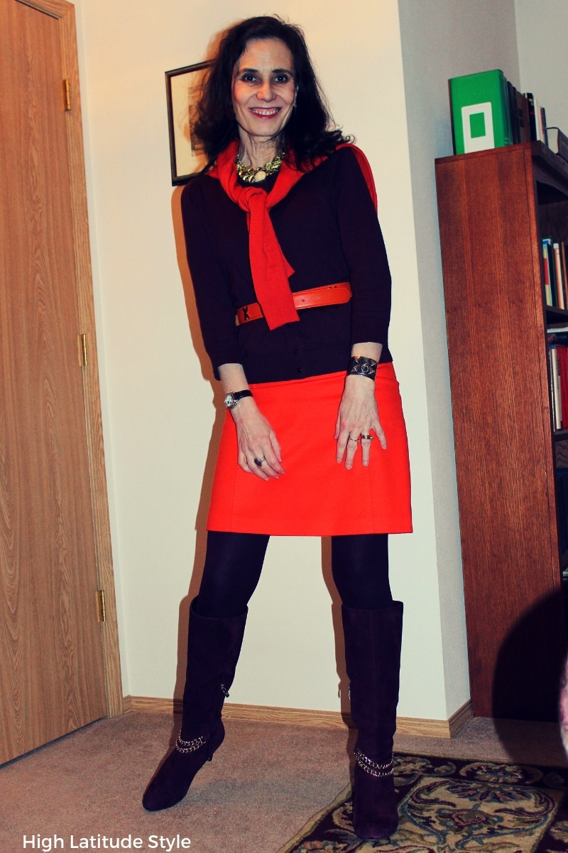 blogger Nicole in orange burgundy color-blocked winter style with skirt, cardi and sweater
