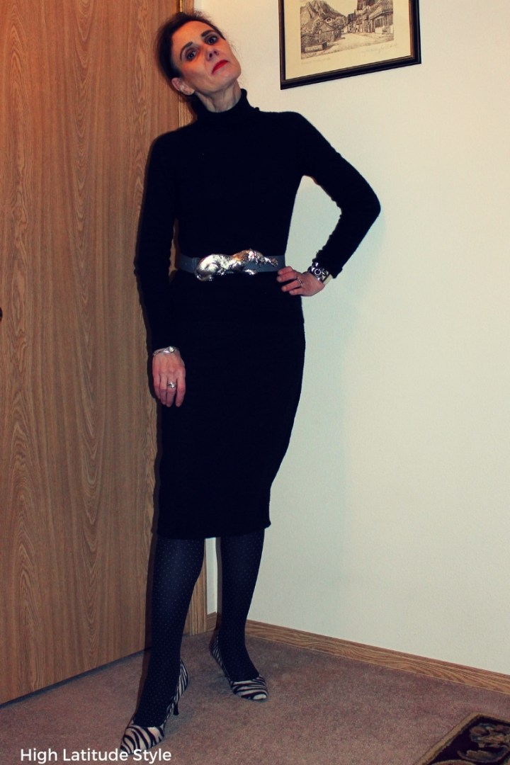 #winterstyle over 50 years old woman in black skirt and top with pinpoint legwear and zebra pumps