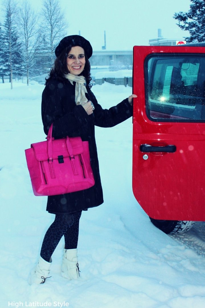#winterouterwear over 50 years old woman in gray shearling, Chervon scarf, beret and fuchsia bag closing a car