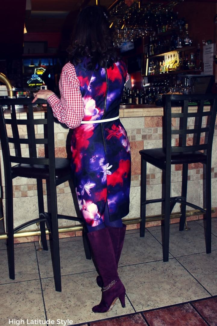 #mixedpatterntrend woman in a floral dress with gingham blouse in red, burgundy, purple, blue, and white