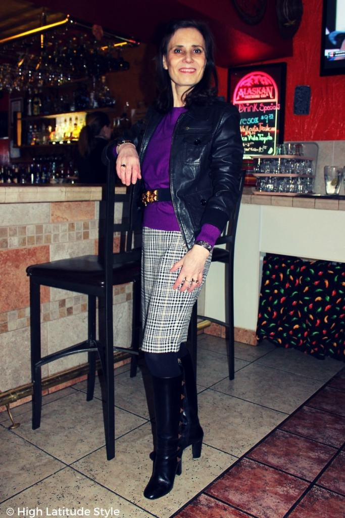 street chic with aviator jacket, purple sweater, knee length skirt and below the knee studded boots