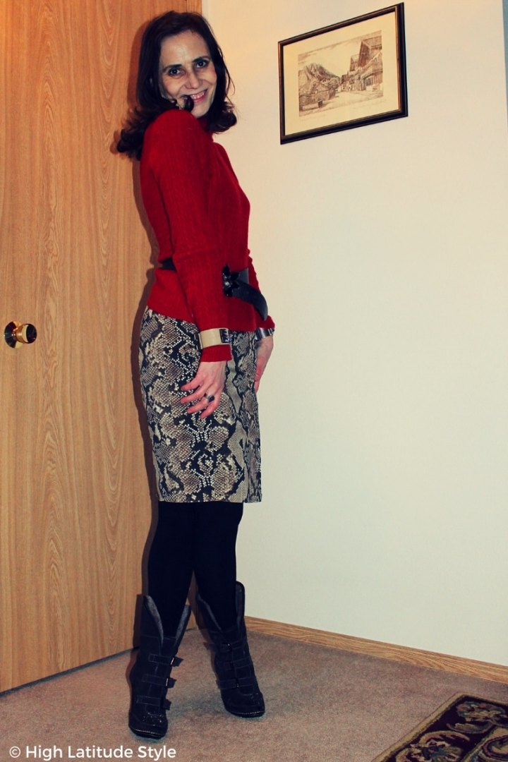 #fashionover50 style blogger in red sweater with neutral color snake print skirt