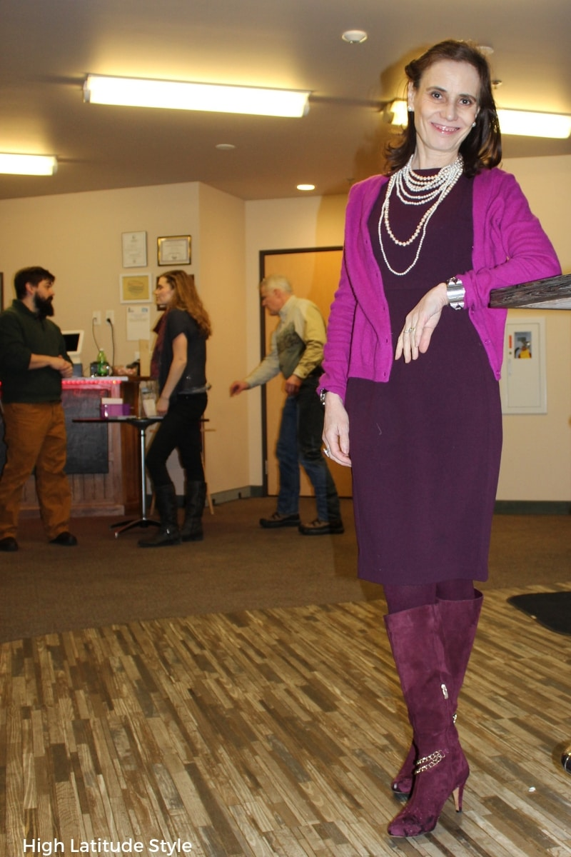 scientist in burgundy and fuchsia business casual look with sheath, cardigan, boots and pearls