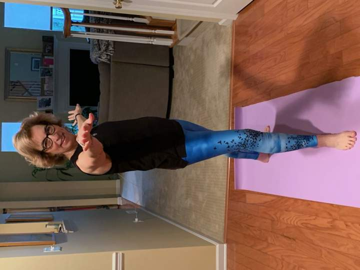 lifestyle blogger Judy Freedman shaping her legs with yoga