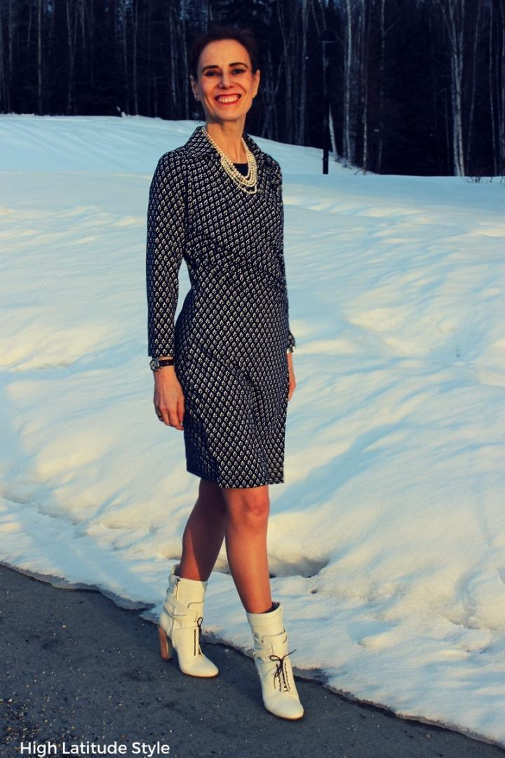 Nicole of High Latitude Style walking in professional blue and white clothing