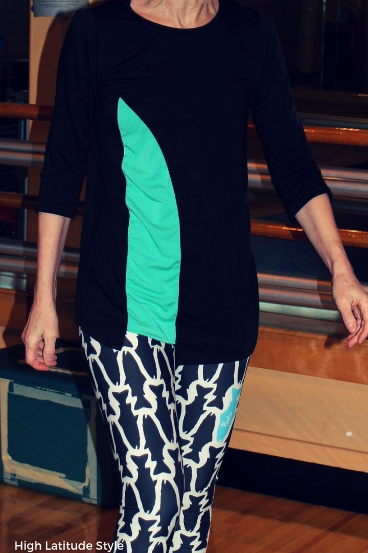 #fitover40 zoom on drappy flow asymmetric black shirt with pop of color and gym leggings
