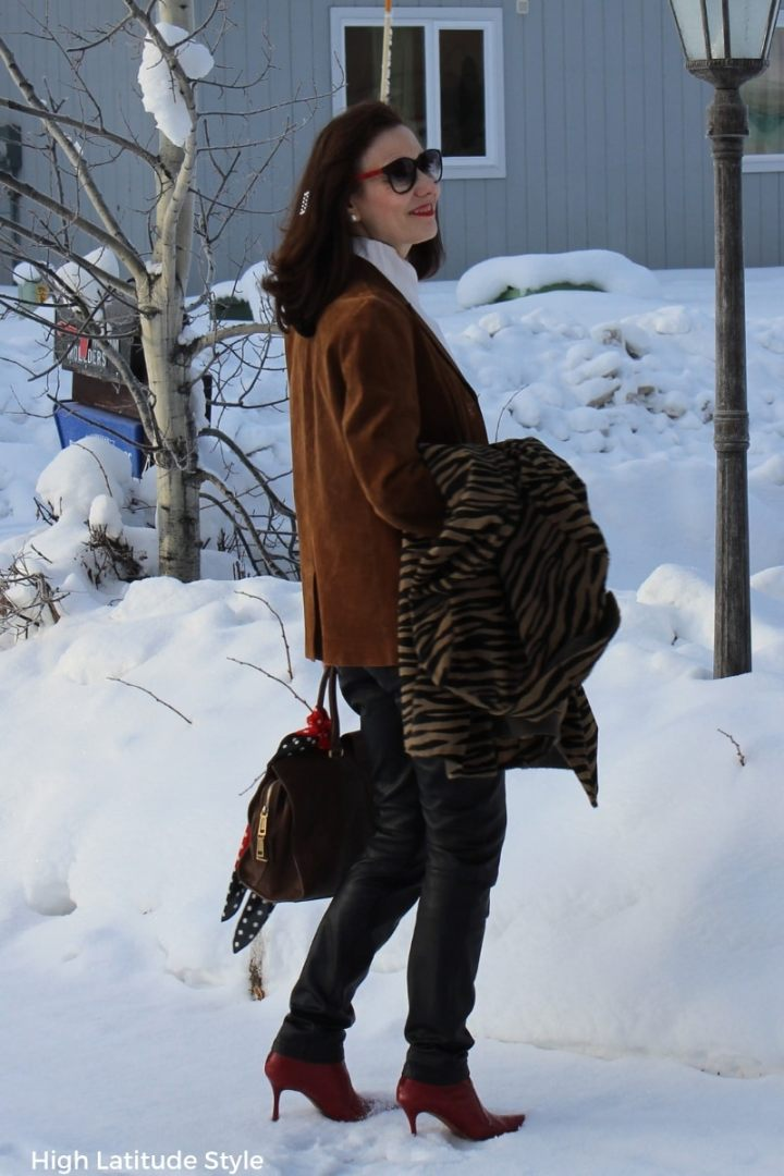 Alaskan blogger in street chic with leather jooging trousers, blazer and zebra print coat