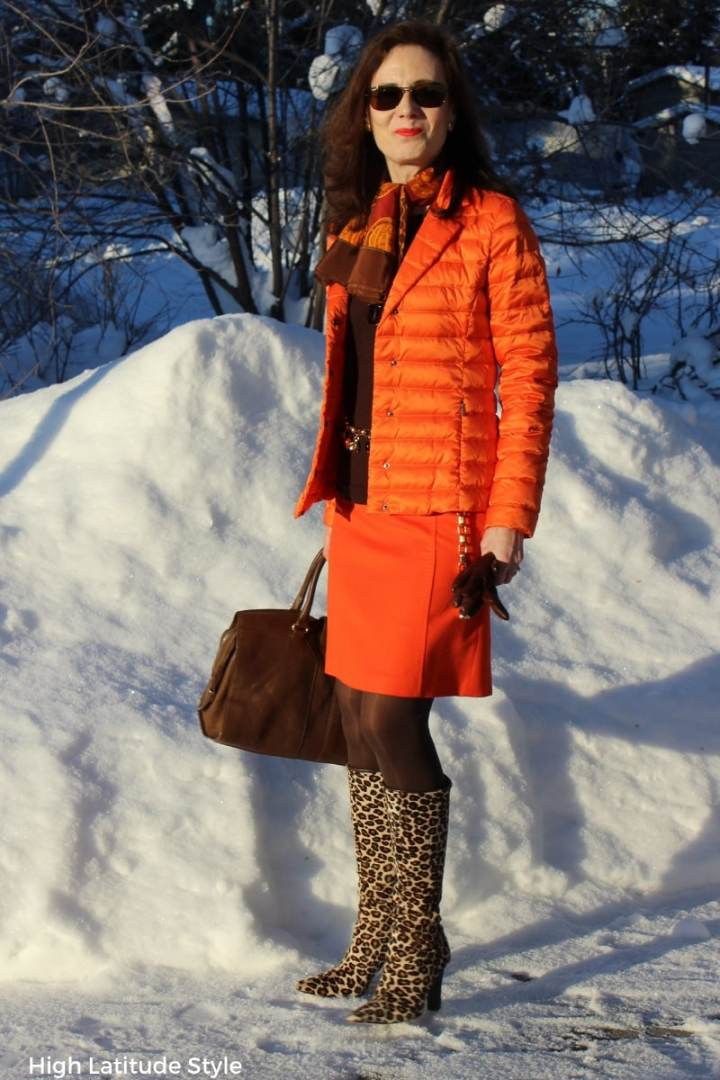 #styleover40 blogger Nicole in casual business brown orange work outfit with wool skirt and puffer jacket