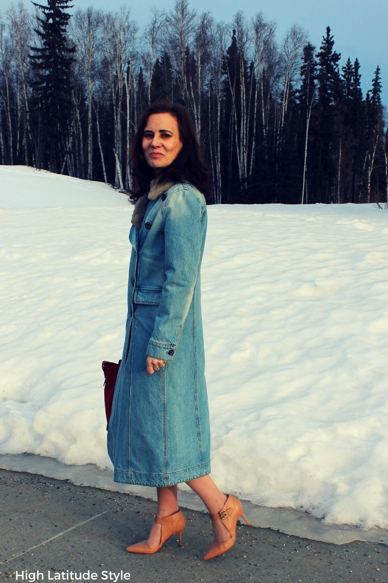 Nicole of High Latitude Style walking on the sidewalk in denim outerwear