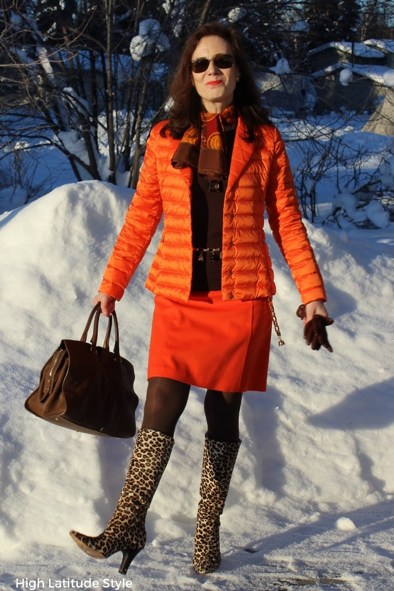 over 50 years old fashion blogger in unmatched orange suit with brown sweater, tights, and accessories