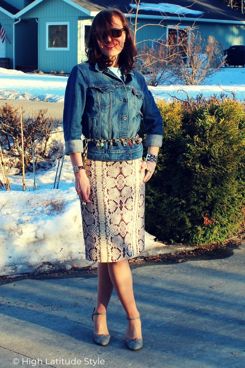 blogger in posh casual trendy outfit with denim and animal print
