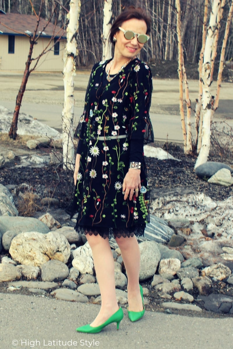 blogger in summer dress styled for spring