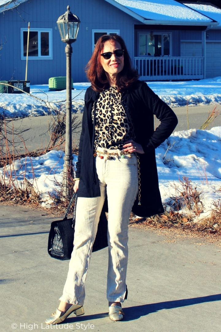 over 50 years old style blogger in spring business casual work outfit with hoodie cardigan animal print top, linnen pants, Gucci footwear