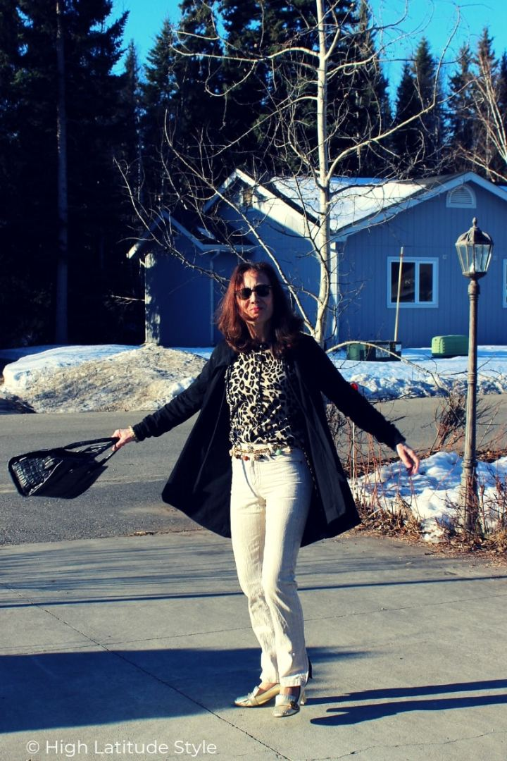 fashion blogger over 50 in linnen pants, cape hoodie, leopard print top, gemstone charm belt