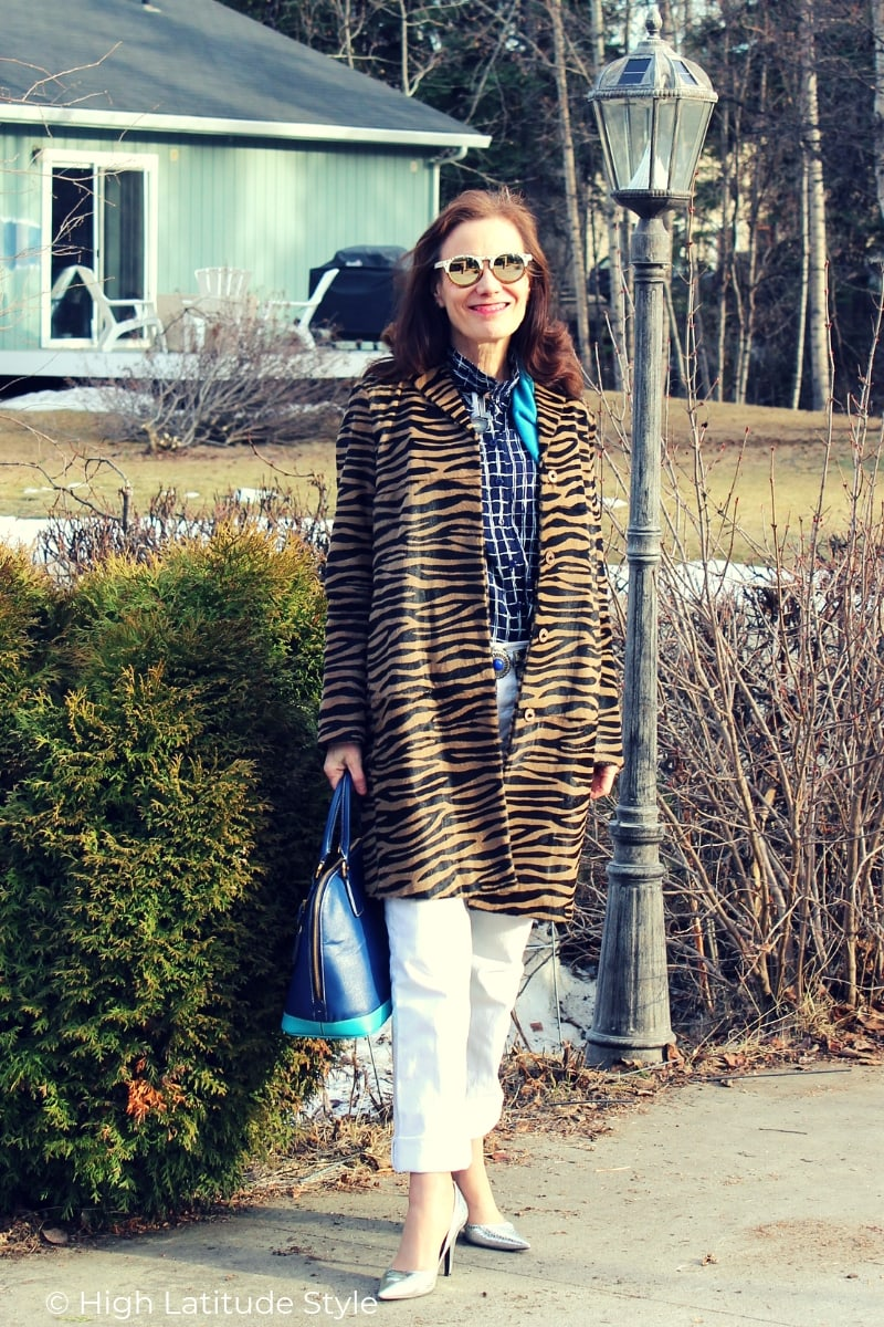 street style look with animal print coat, window panel button-down, white denim pants and mirrored sunnies