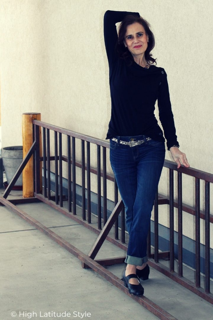 blogger Nicole posing in rolled-up denim pants, longshleeve button embellished asymetric top and trendy ballerinas