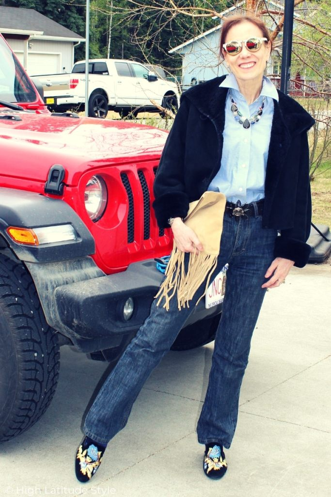 zoom on Alaskan weekend look with hoodie, button-down, bf jeans, mules, sunnies and fringe bag