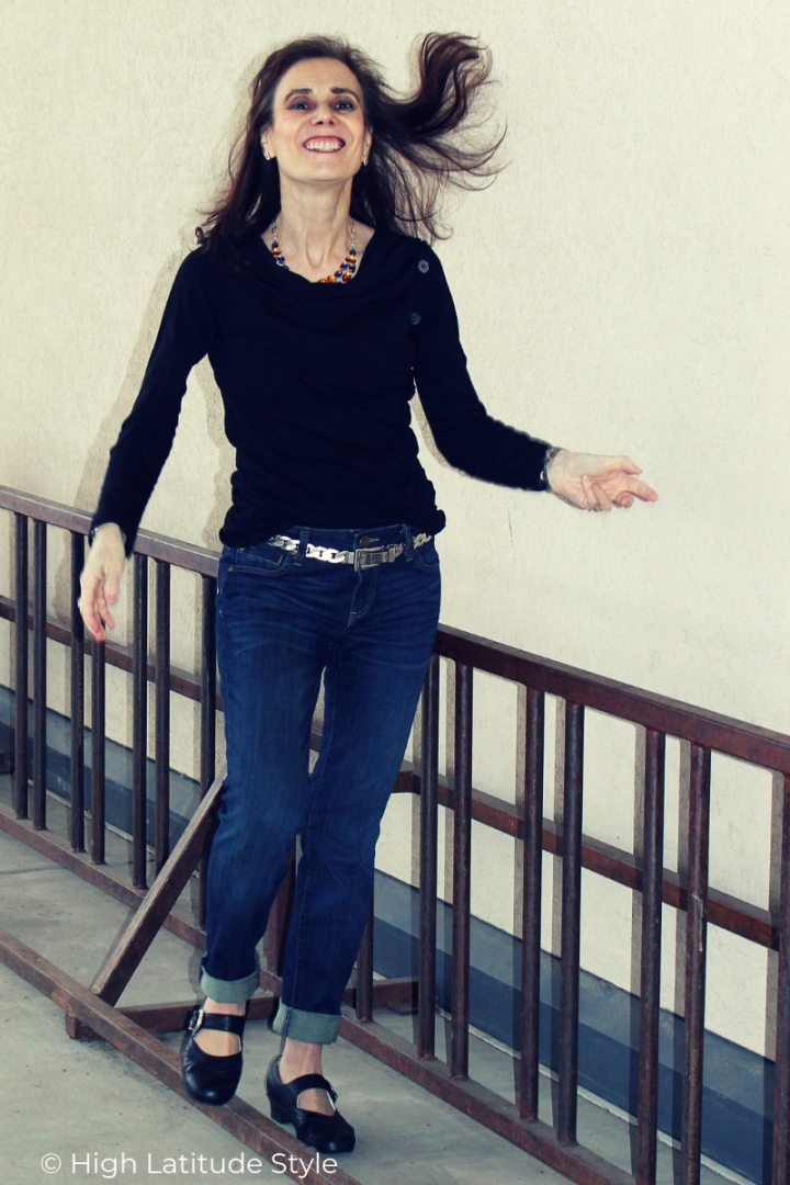 Nicole of High Latitude style jumping in ballet flats trend wearing a casual weekend look with BF and black top