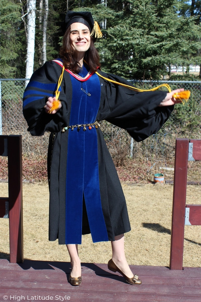 over 50 years old woman wearing doctoral regalia