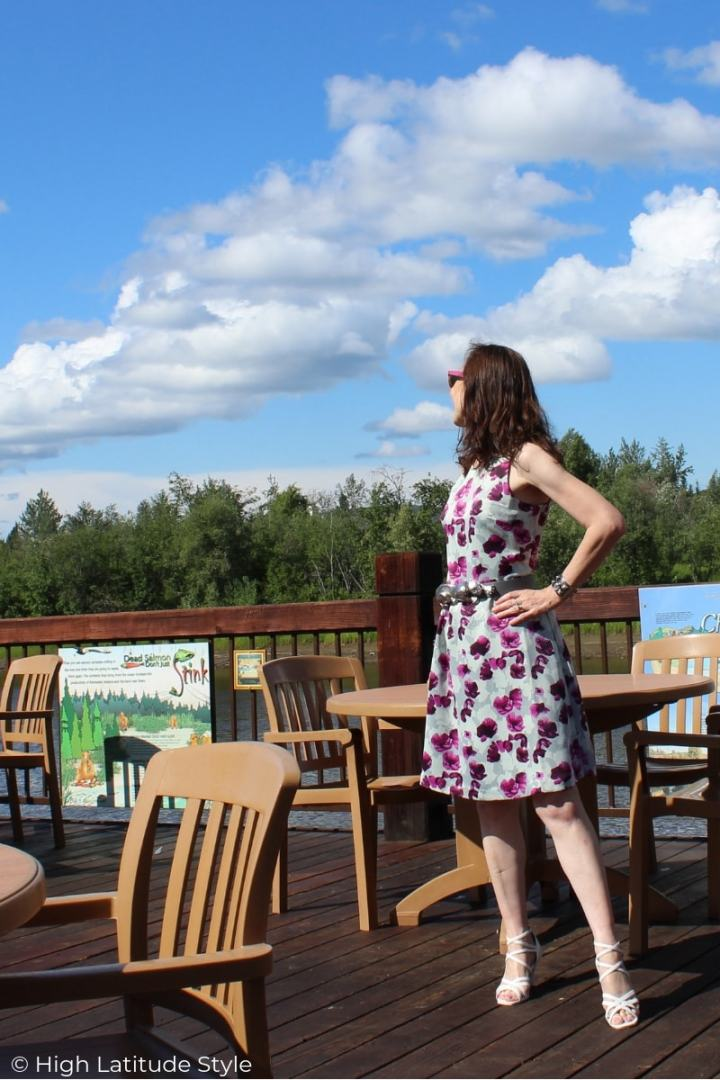 Alaskan style blogger at the Chena river in fit-and-flare summer dress, sandals