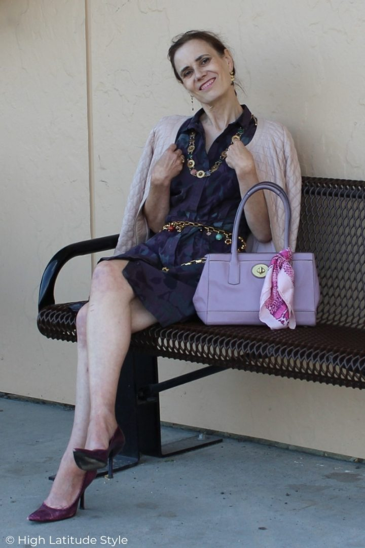 details of mature women's summer work outfit in purple and pink hues