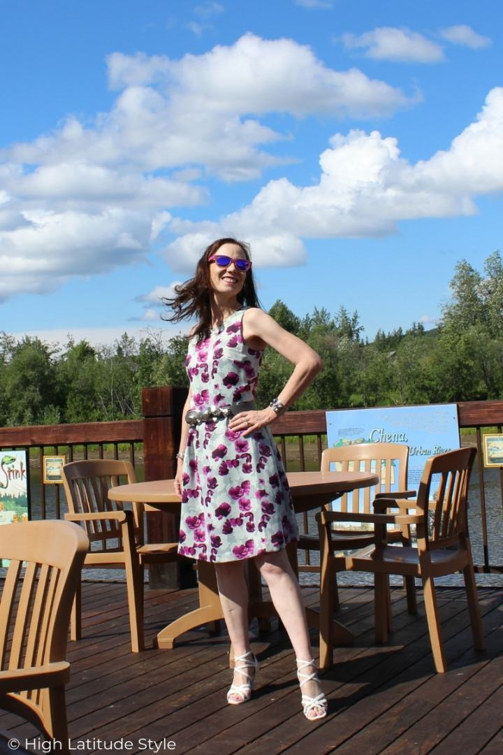 midlife blogger in a summer dress styled casually with sandals for the office