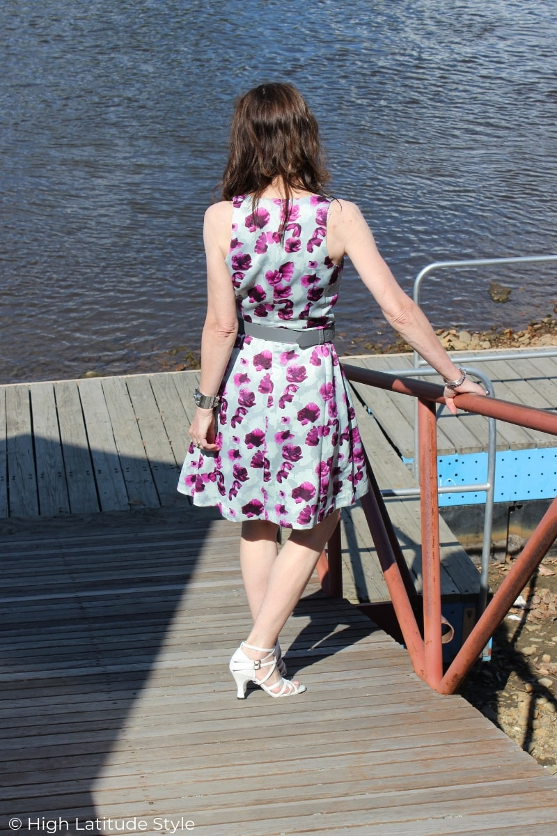 style blogger over 50 walking down a boating deck