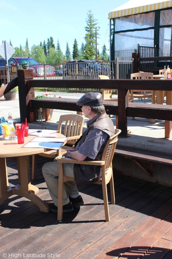 man in casual summer look with ivy head gear at an eating place close to Fairbanks