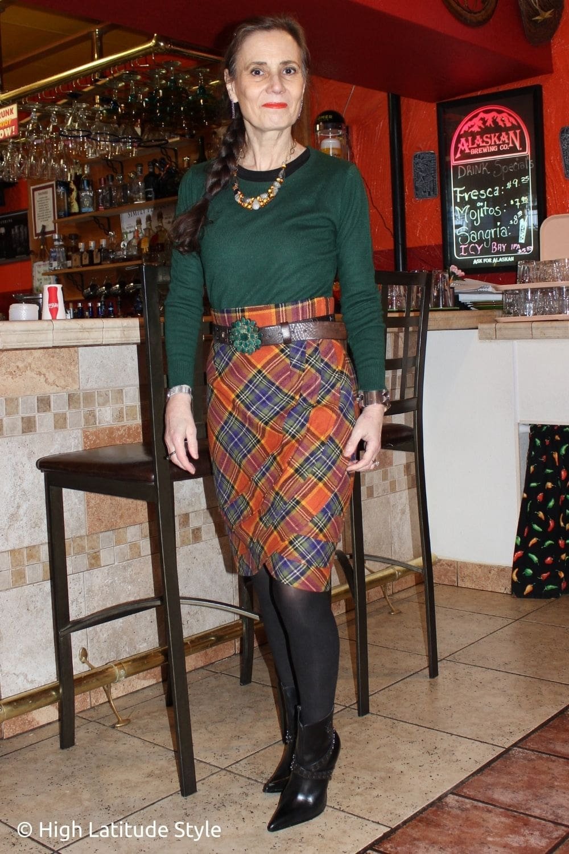 blogger in green top, orange tartan, black tights and booties