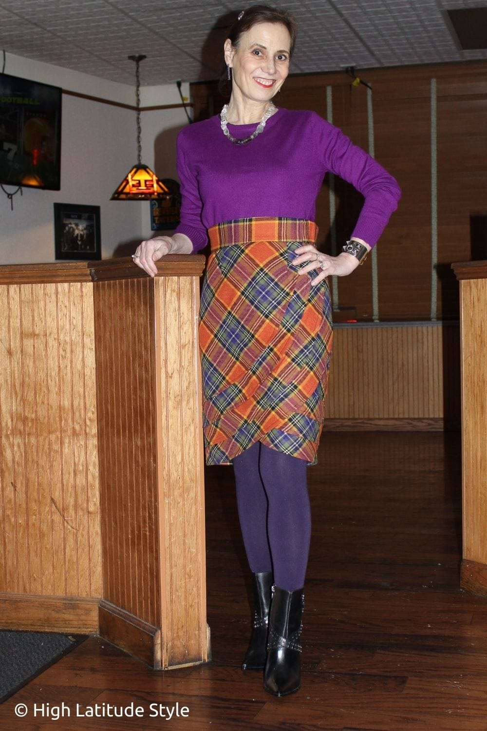 style influencer in orange skirt, purple top and tights