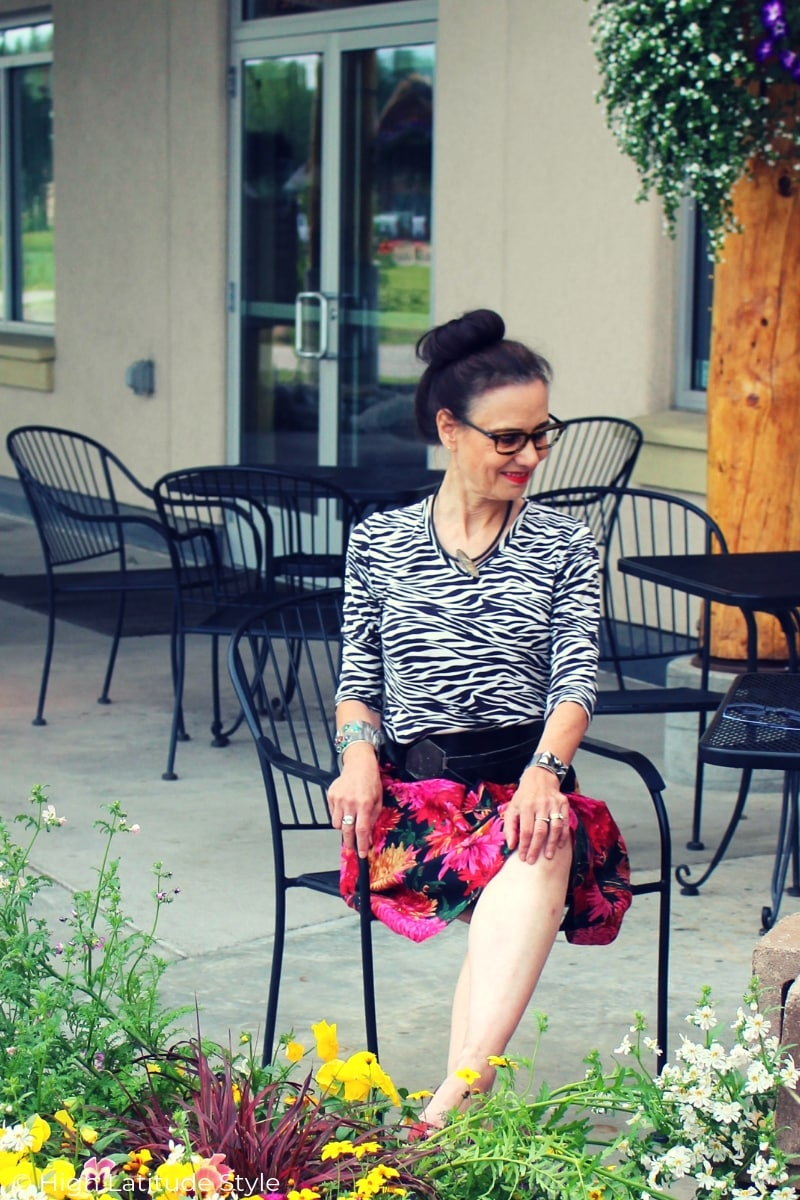 over 50 years old style book author with mixed print skirt and shirt and tortoise glasses