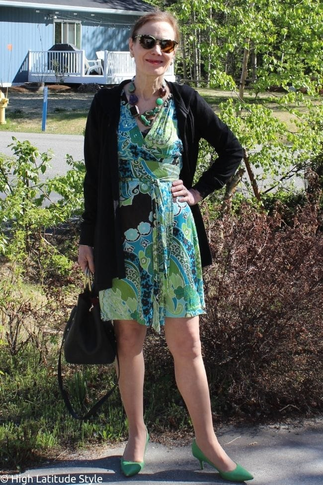 stylist in silk paisley print wrap dress with cape hoodie and green pumps