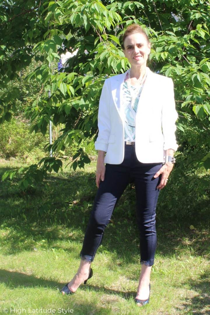midlife woman in summer work look of pants, printed top, blazer and open-toe pumps