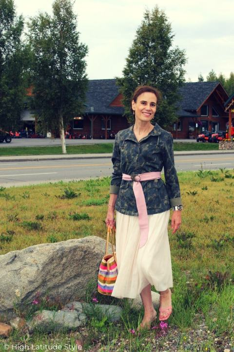 style book author in camo top, tulle skirt, striped bag, belt and mules
