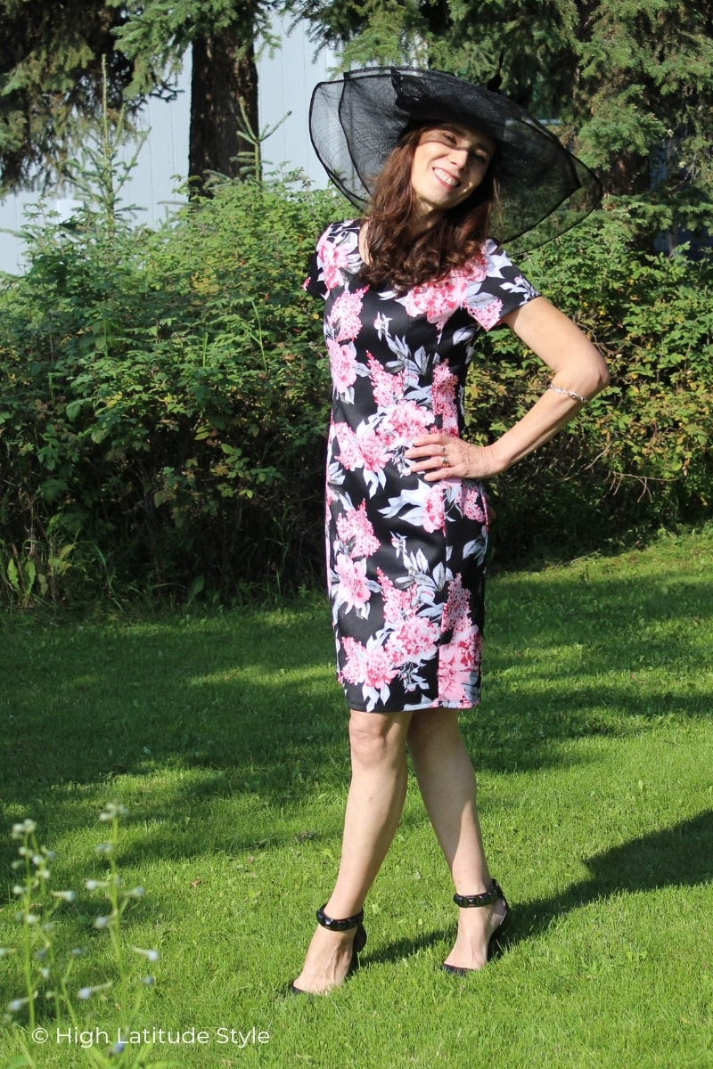 style book author in floral curch outfit with straw hat
