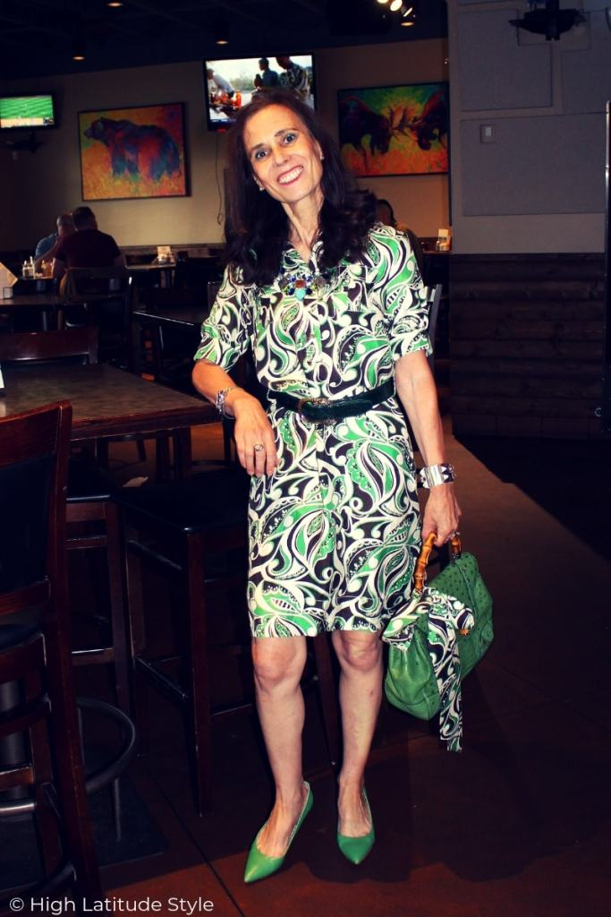 over 50 years old fashion blogger in silk shirt dress with matching belt, bag and heels