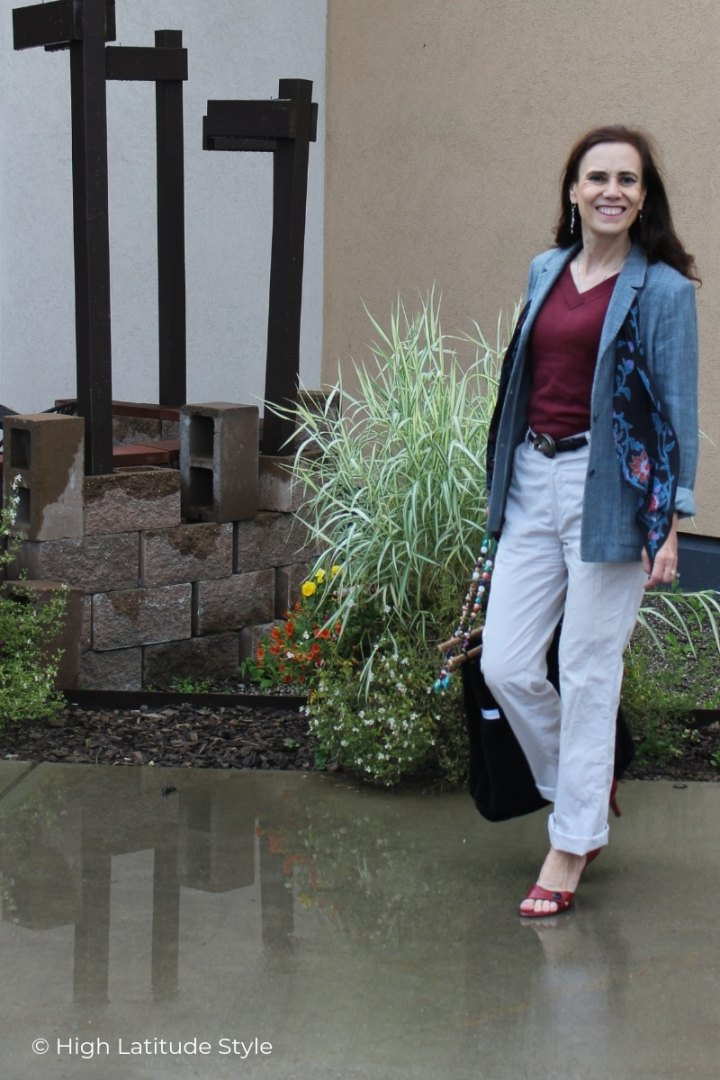 Alaskan woman in chinos, blazer, sweater on a rainy August day