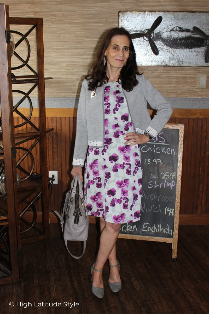 Nicole of High Latitude Style in abtract floral print dress, cropped scuba jacket and ankle strap pumps