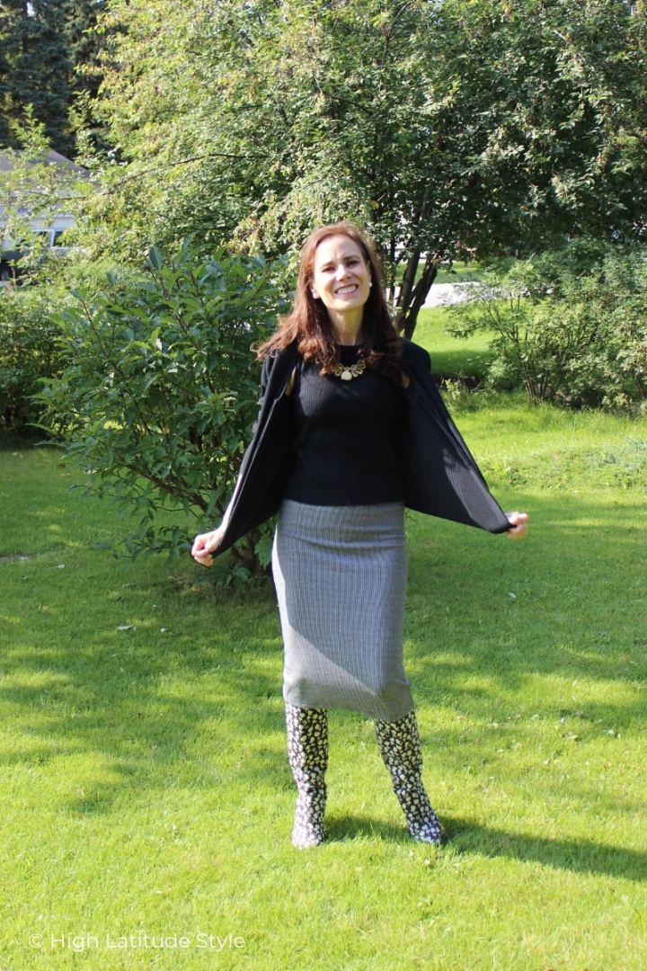 Nicole of High Latitude Style in fall work outfit with top, cardigan skirt and tall boots