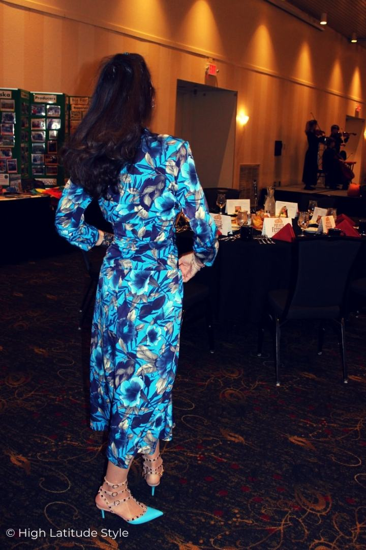 fashion blogger in self-made turquoise abstract floral print 40s inspired dress and Valentino studs