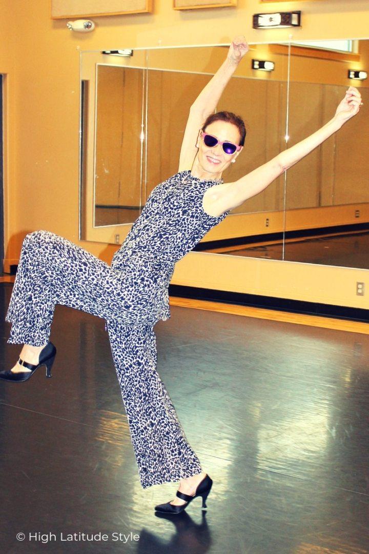 dancer in coolibar clothing exercising her balance