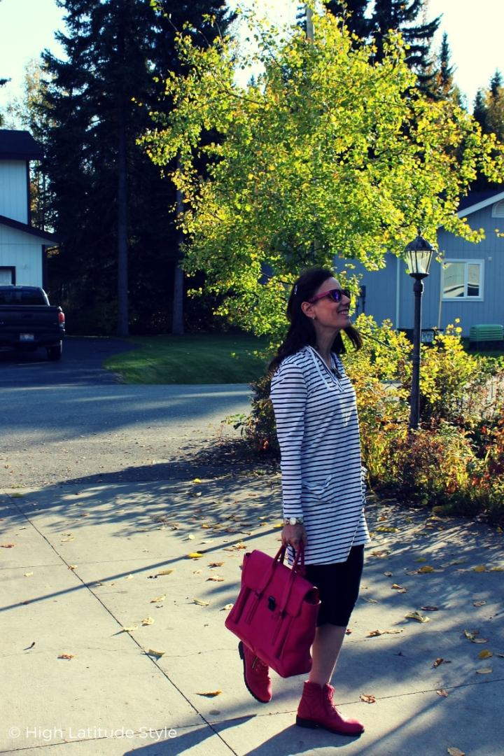 Nicole in pants, beach coverup, sunnies with pink sneakers and tote
