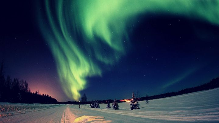 street in Alaska to a settlement with bonfire and aurora in stary sky