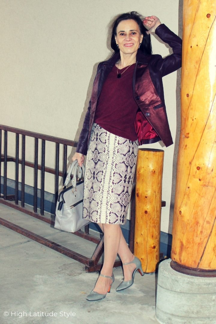 over 50 years old blogger in snake print knee length skirt, color matching top, blazer, shoes and bag