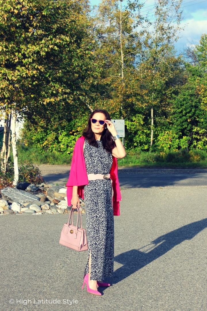 fashion blogger in sunprotective Coolibar snoew leopard print top and pants with pink accessories