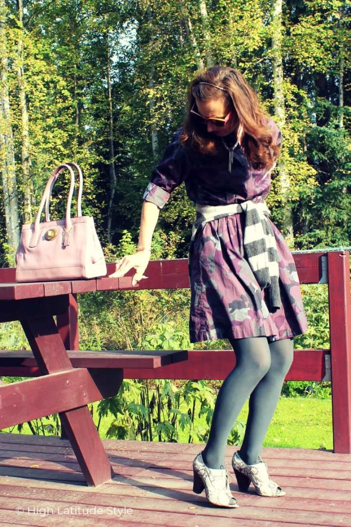 blogger on the verge to sit down on a picnic bench in autumn