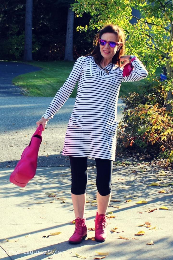 woman in sunprotective Coolibar hoodie plus pants